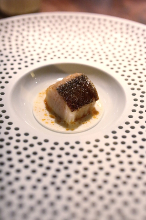 Black cod grilled over the embers sauce of yoghurt and citrus leaves.