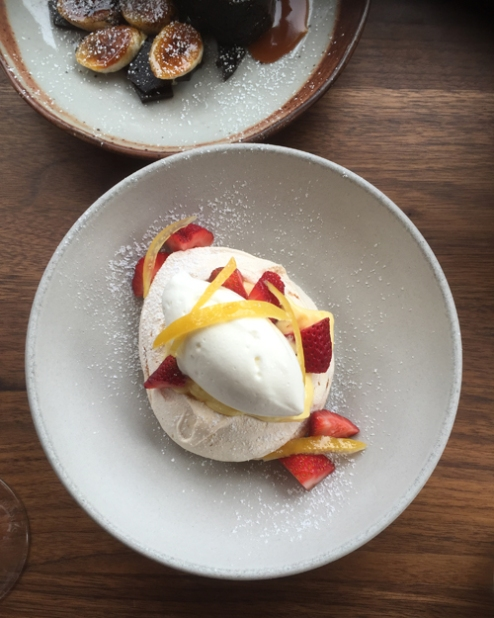 Meyer lemon pavlova with Albion strawberry, rose geranium chantilly and candied lemon.