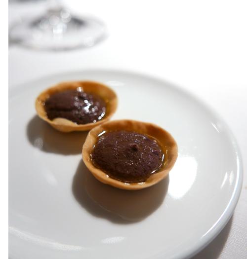 Tartellette with olive oil and black olives.