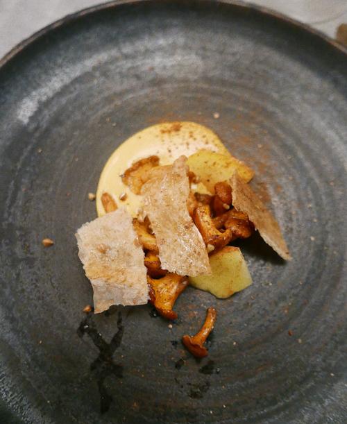 Chanterelles, egg yolk and chicken skin.