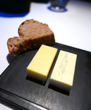 Potato bread with two kinds of butter.