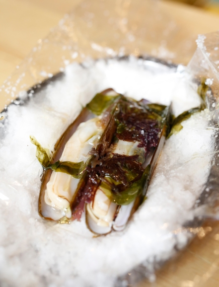 Razor clams with seaweed.